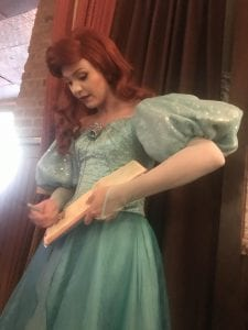 Ariel signing autograph book