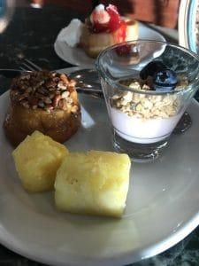 Fresh fruit, sticky buns, yogurt and Mickey Waffles