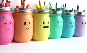 Painted Mason Jar Pencil Holder with cute faces